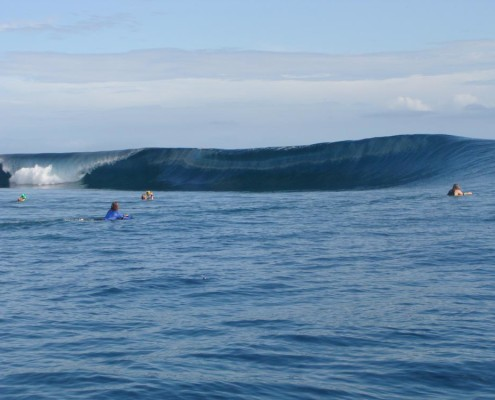 Surfing Fiji Pipe or Teahupoo